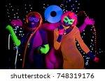 3 cyber glow raver friends... | Shutterstock . vector #748319176