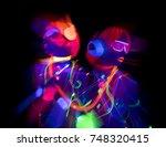 2 sexy cyber glow raver women... | Shutterstock . vector #748320415