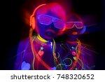 2 sexy cyber glow raver women...   Shutterstock . vector #748320652