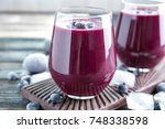 glass with acai juice on wooden ... | Shutterstock . vector #748338598