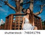 portrait of a beautiful mixed... | Shutterstock . vector #748341796