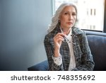 thoughtful old woman is posing... | Shutterstock . vector #748355692
