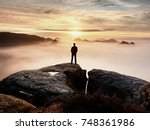 man silhouette stay on sharp... | Shutterstock . vector #748361986