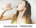 young cute girl in green tops... | Shutterstock . vector #748362382