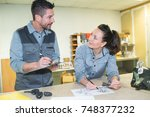 man teaching woman during... | Shutterstock . vector #748377232