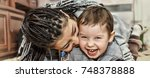 dark skinned mother plays with... | Shutterstock . vector #748378888