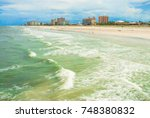 People are enjoying a beautiful summer day on a beach in Jacksonville Beach Florida. This is computer generated art from a photograph.