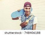 young man african descent teen... | Shutterstock . vector #748406188