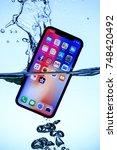iphone x in water  2017 11 04... | Shutterstock . vector #748420492