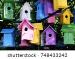 colorful bird houses closeup... | Shutterstock . vector #748433242