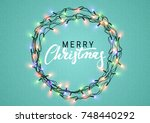 christmas glowing lights.... | Shutterstock . vector #748440292