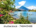 beautiful bay of lake atitlan... | Shutterstock . vector #748445488