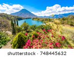 beautiful bay of lake atitlan... | Shutterstock . vector #748445632