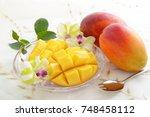 fresh mangoes | Shutterstock . vector #748458112