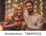 beautiful young couple is... | Shutterstock . vector #748493122