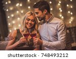 beautiful young couple is... | Shutterstock . vector #748493212
