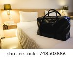 big black luggage bag on the... | Shutterstock . vector #748503886