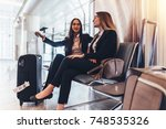 two business ladies waiting for ... | Shutterstock . vector #748535326