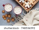 christmas background with cups... | Shutterstock . vector #748536592