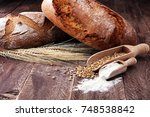 freshly baked bread and flour... | Shutterstock . vector #748538842