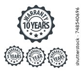 years warranty stamp icon set | Shutterstock .eps vector #748540696
