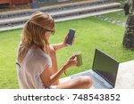 girl holding cellphone  coffe... | Shutterstock . vector #748543852