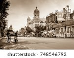 Small photo of August 06,2017. kolkata , West bengal, India.Monochrome view of a heritage hand pulled rickshaw on Kolkata city street with the Metropolitan building at the background.