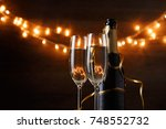 festive photo of two wine... | Shutterstock . vector #748552732