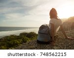 tourist girl with backpack...   Shutterstock . vector #748562215