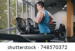 strong man in the gym  ... | Shutterstock . vector #748570372