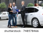 young couple with car dealer... | Shutterstock . vector #748578466