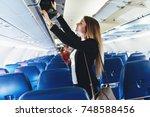 female student putting her hand ... | Shutterstock . vector #748588456