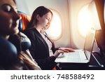 female entrepreneur working on... | Shutterstock . vector #748588492