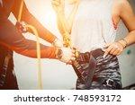 climbing equipment. man... | Shutterstock . vector #748593172