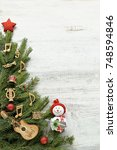 christmas tree branches with... | Shutterstock . vector #748594846