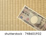 Small photo of Japanese 10,000 (ten-thousand) yen note on tatami matting