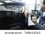 car detailing   hands with... | Shutterstock . vector #748614262