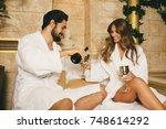 beautiful young couple enjoying ... | Shutterstock . vector #748614292