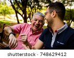 dad interacting with his new... | Shutterstock . vector #748629412