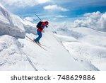 good skiing in the snowy... | Shutterstock . vector #748629886