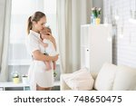 mom with a newborn baby two... | Shutterstock . vector #748650475