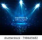 stage spot lighting. magic...   Shutterstock .eps vector #748665682