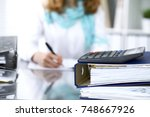 calculator and binders with... | Shutterstock . vector #748667926