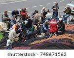 the fishermen are repairing... | Shutterstock . vector #748671562