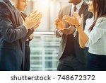 business people team applauding ...   Shutterstock . vector #748672372