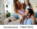 happy family having fun times... | Shutterstock . vector #748673092
