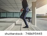 runner businessman hurrying to... | Shutterstock . vector #748695445