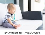 little baby boy with soother or ... | Shutterstock . vector #748709296