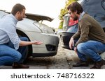two men arguing after a car... | Shutterstock . vector #748716322