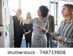 diverse group of focused... | Shutterstock . vector #748719808